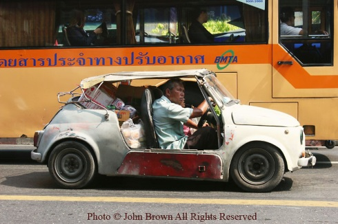 Man-Driving-A-Car-In-Bangkok-Thailand