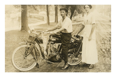 black-and-white-photo-of-man-and-woman-by-vintage-motorcycle
